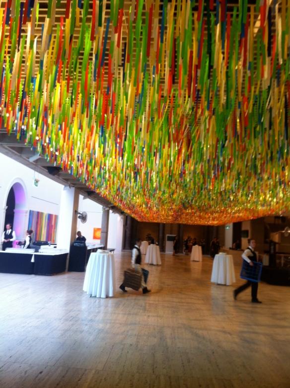 """Preparations for the opening under Nike Savvas' installation """"Rally""""."""